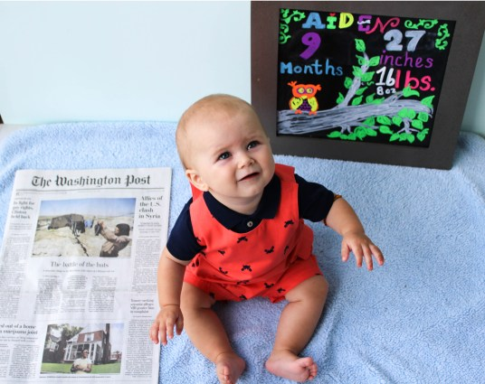 Aiden nine months paper - Monthly Milestone Photos for Baby featured by popular DC mommy blogger, Baby Castan on Board