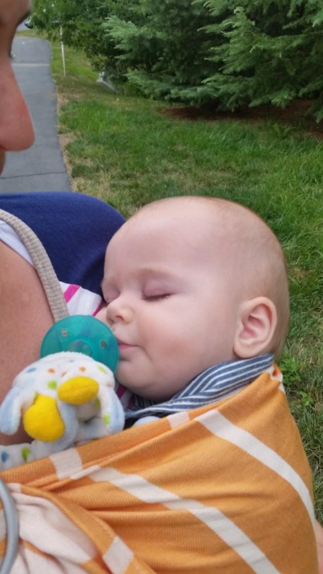 Baby wearing ring sling sleep