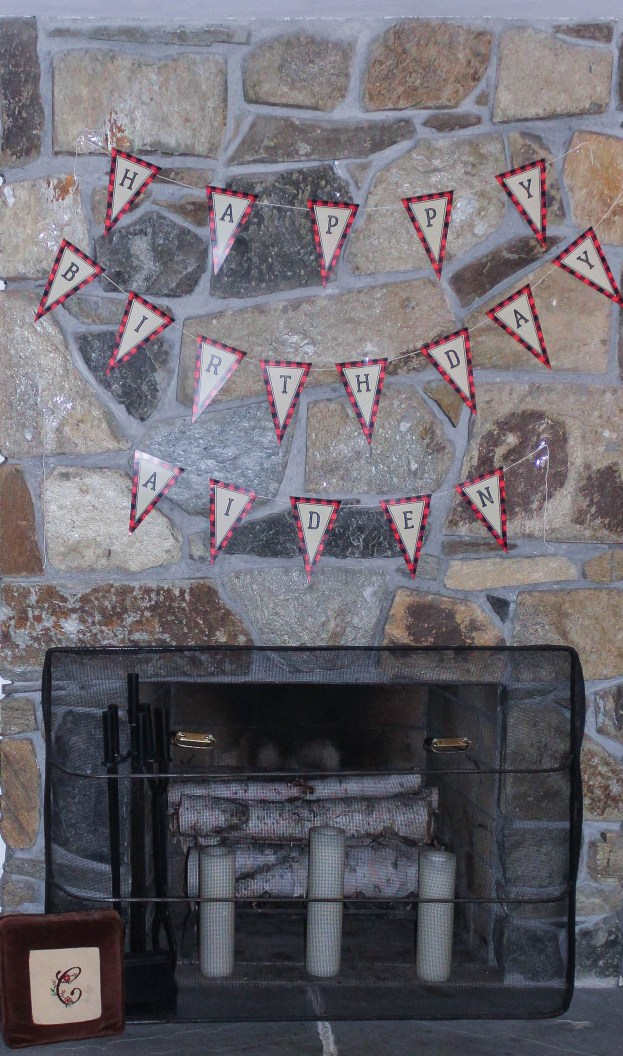 This post is about Aiden's lumberjack first birthday party. Great printable, decor and food ideas for throwing a lumberjack first birthday party.