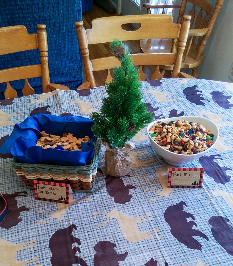 This post is about Aiden's lumberjack first birthday party. Great printable, decor and food ideas for throwing a lumberjack first birthday party. - A Lumberjack Party by popular DC lifestyle blogger Baby Castan on Board