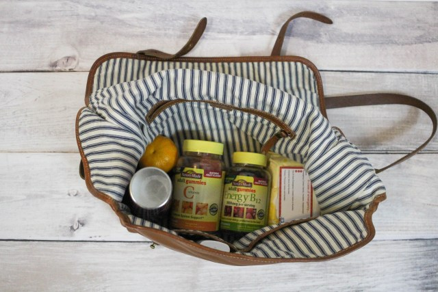 This post is all about how I survive working mom life and what I include in my everyday bag including Nature Made® Adult Gummies which help keep me healthy. #AGummyYouCanTrust #NatureMade #NatureMadeAdultGummies #USP #momlife #workingmom #vitamins