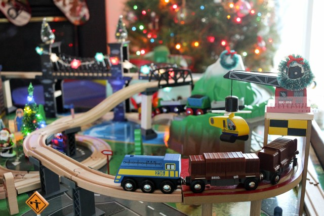 i decided to use our toddlers train table as part of our holiday decor i - Christmas Train Decoration