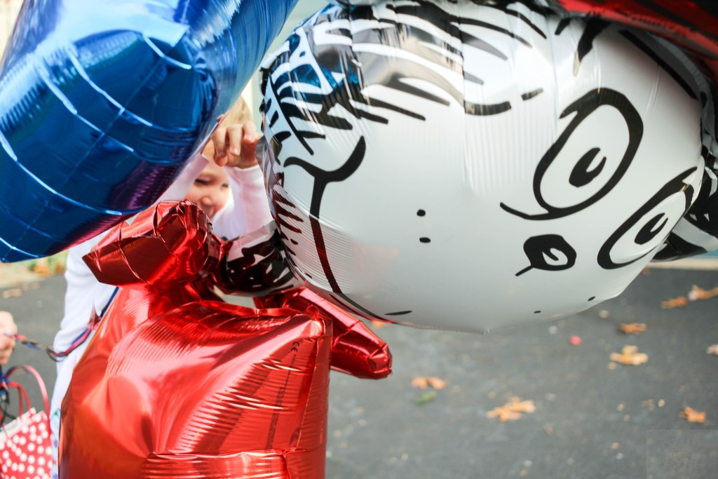 Dr. Seuss Themed Birthday-two-year-old-with-Dr-Seuss-balloon-DC-Motherhood Blog
