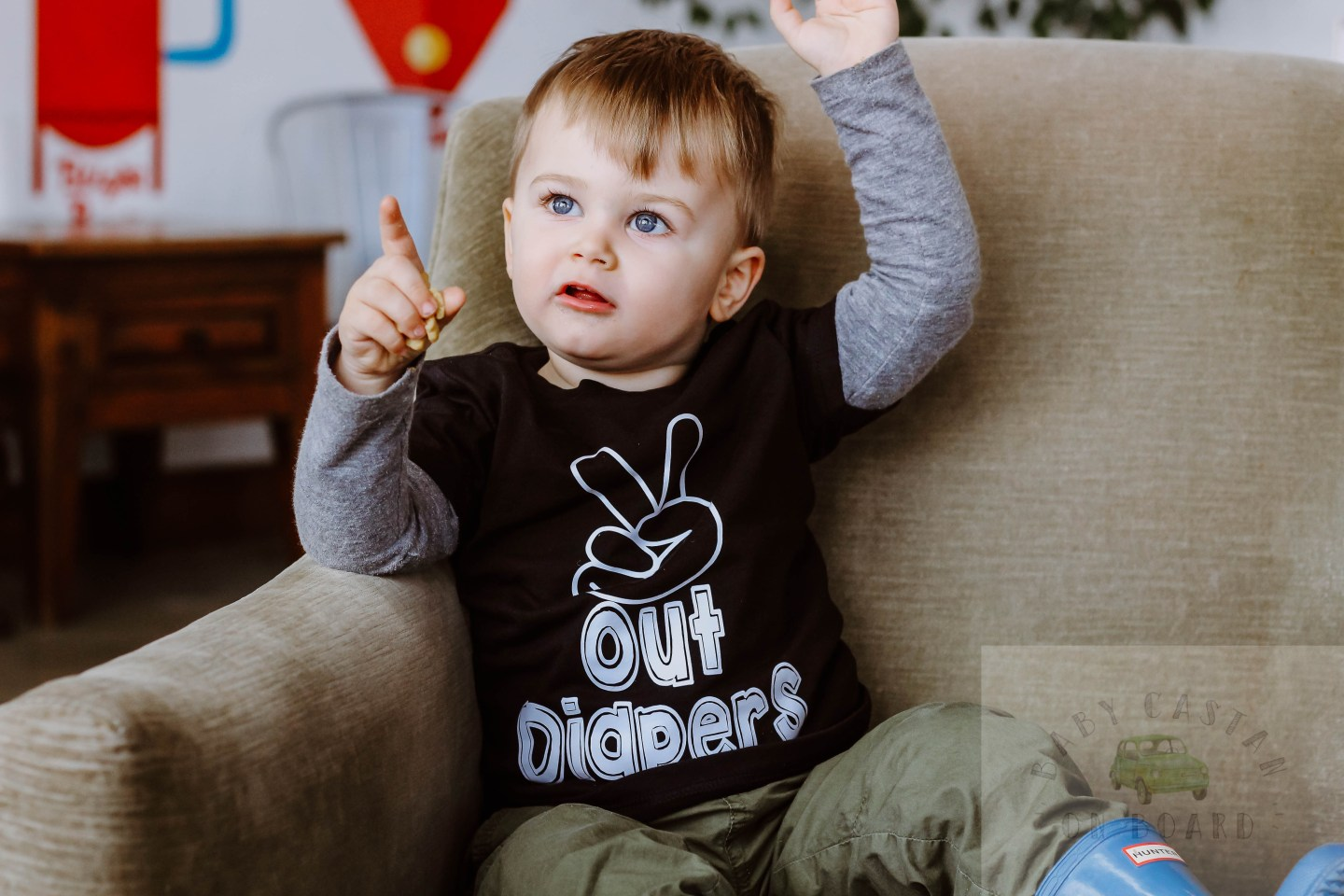 Potty Training Guide_Toddler sitting in Peace Out Diaper Tee