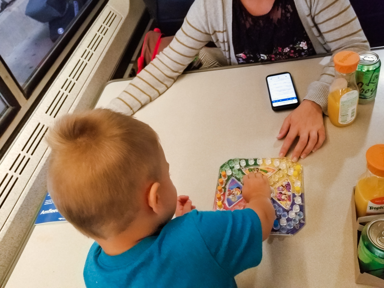 Train travel with a toddler_toddler playing trouble