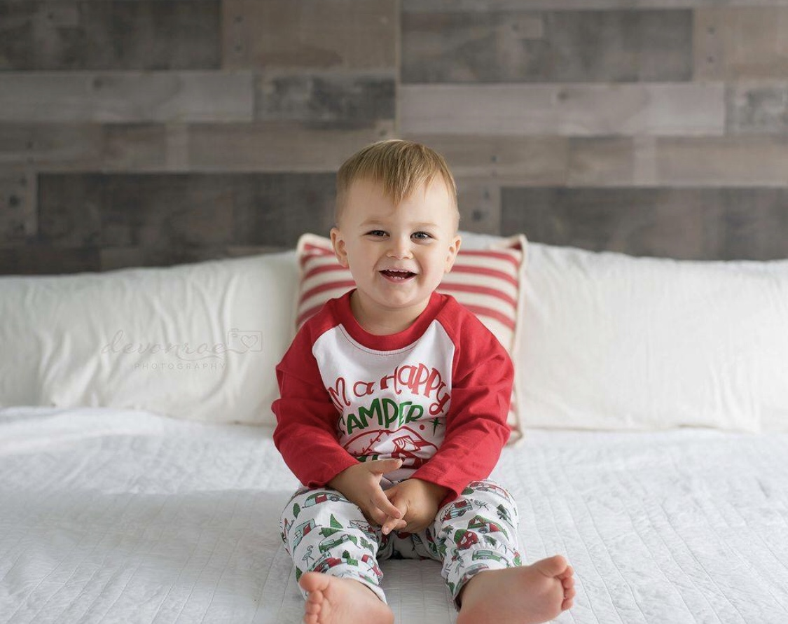 Holiday Photography Tips featured by top DC mommy blogger, Baby Castan on Board: toddler wearing Christmas pajamas