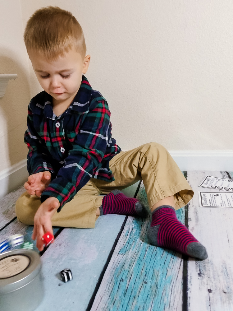 Top 3 Subscription boxes for toddlers, featured by top DC mommy blogger, Baby Castan on Board: toddler playing with dice