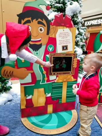 Toddler talking to santa's elf
