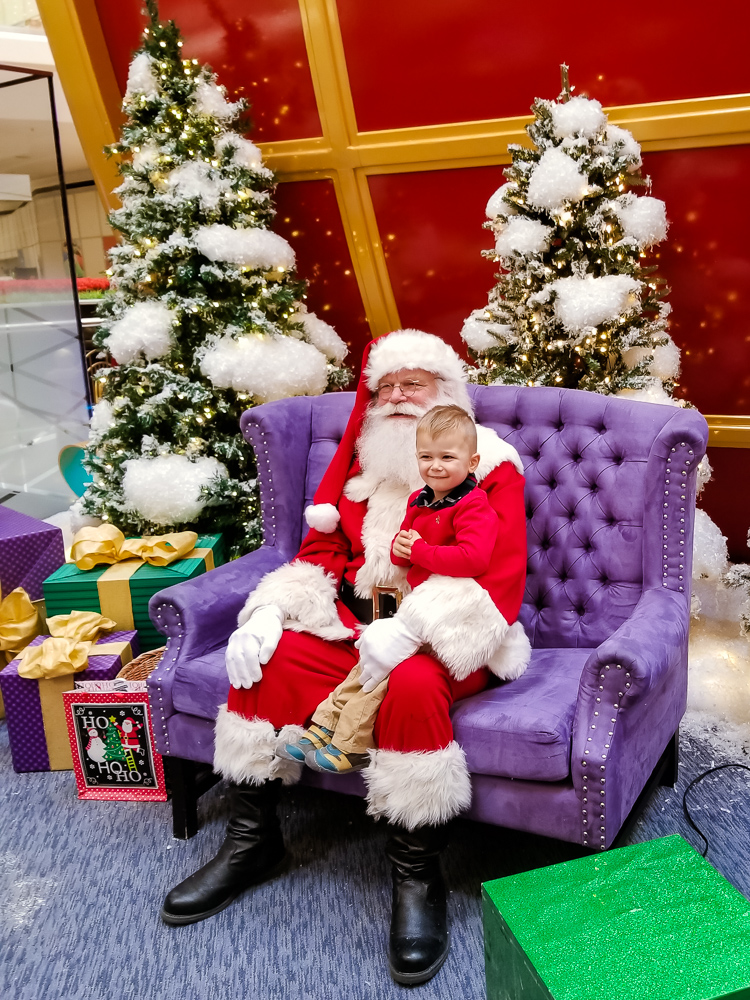 The Secret to a Cry-Free Santa Visit with a Toddler featured by top DC mommy blogger, Baby Castan on Board: toddler with Santa