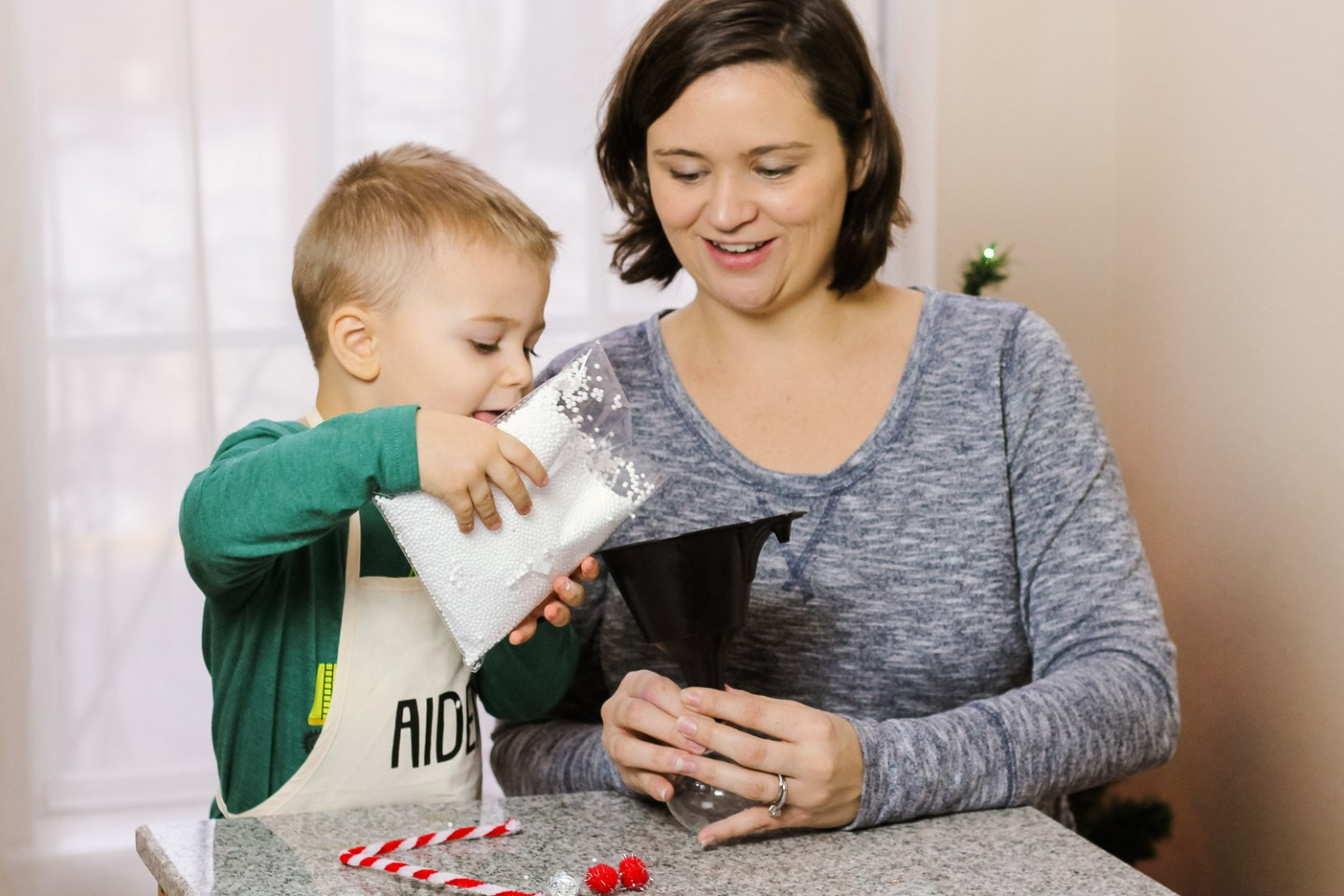 Easy Holiday crafts featured by top Washington DC mommy blog, Baby Castan on Board: image of a mom and toddler making a snowman ornament craft together