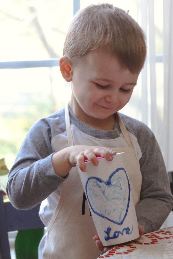 Heart crafts for toddlers_toddler holding travel mug