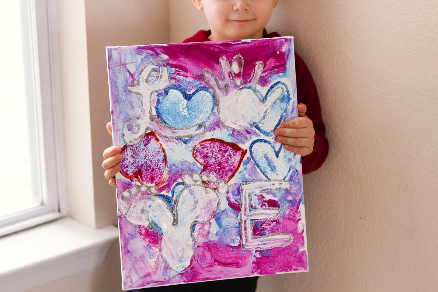 Heart crafts for toddlers_toddler with love canvas closeup