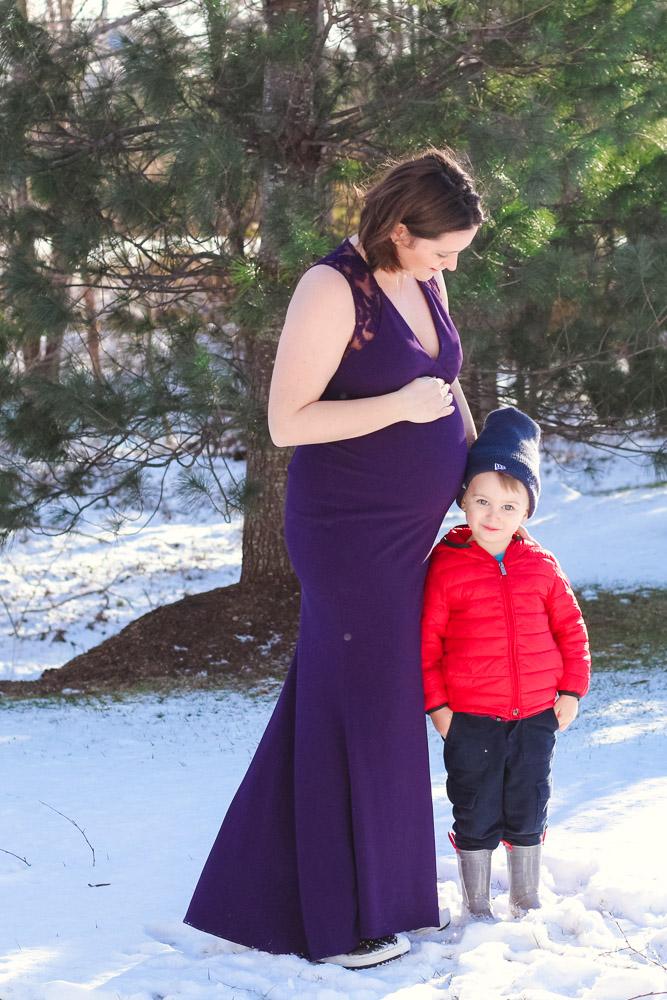 Maternity photos_pregnant mom purple dress snuggling toddler