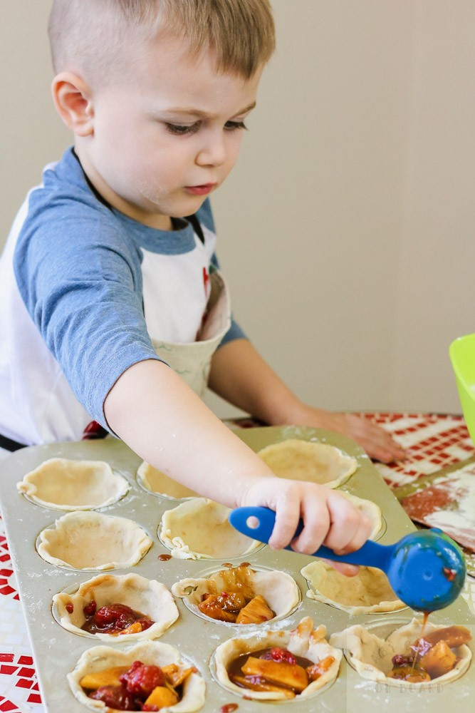 Super Cute Valentine's Day Dessert you Can Make with your Toddler featured by top US mommy blog, Baby Castan on Board: image of a toddler making delicious Valentines Day pies