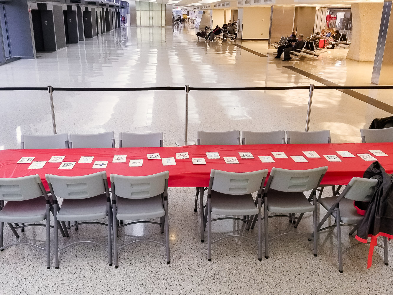 How to Plan a Birthday Party at the Airport for Your Child by popular DC mommy blog, Baby Castan on Board: image of table and chairs set up in an airport terminal.