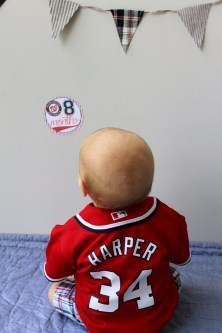 Aiden in Harper jersey with eight month sticker
