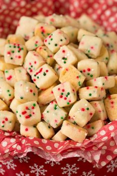 Christmas Shortbread Bites in a red tin