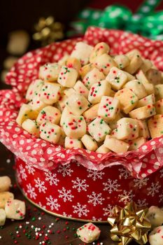 Christmas Shortbread Bites in a red cookie tin
