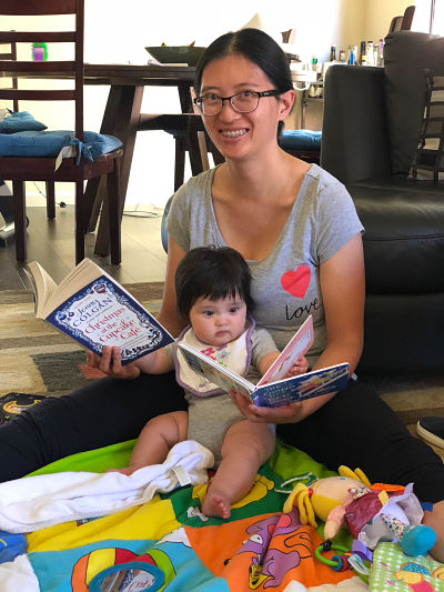 Baby Librarian Tilly reads with her mum, Jen