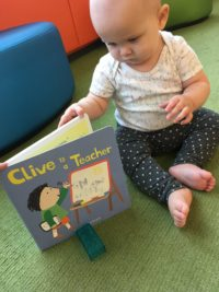 Marian reading Clive is a Teacher by Jessica Spanyol