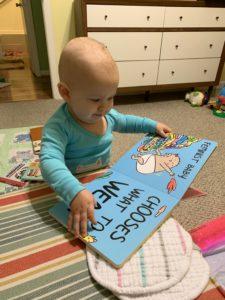 Marian reads Feminist Baby by Loryn Brantz