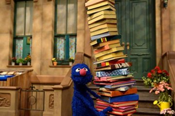 Grover carrying books