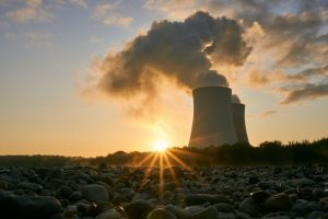 low angle photo of nuclear power plant buildings emtting 3044470