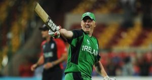 An Irish batsman celebrating with an English player in the background
