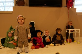 Baby Costume Parade! We tried to get them all in the picture (let alone look at the camera)...