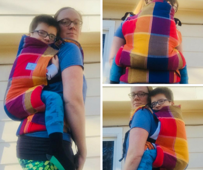 Three image collage of a bespectacled white woman wearing her bespectacled son on her back in a multi-colored large plaid patterned soft structured buckle carrier. Image feature side and back angles of the carrier.