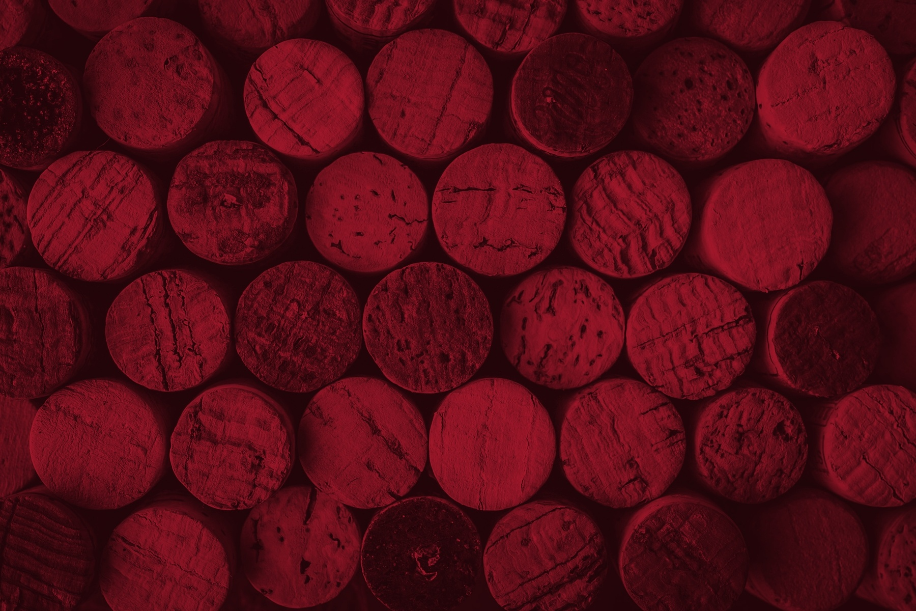wine and spirit corks bunched together with red image overlay