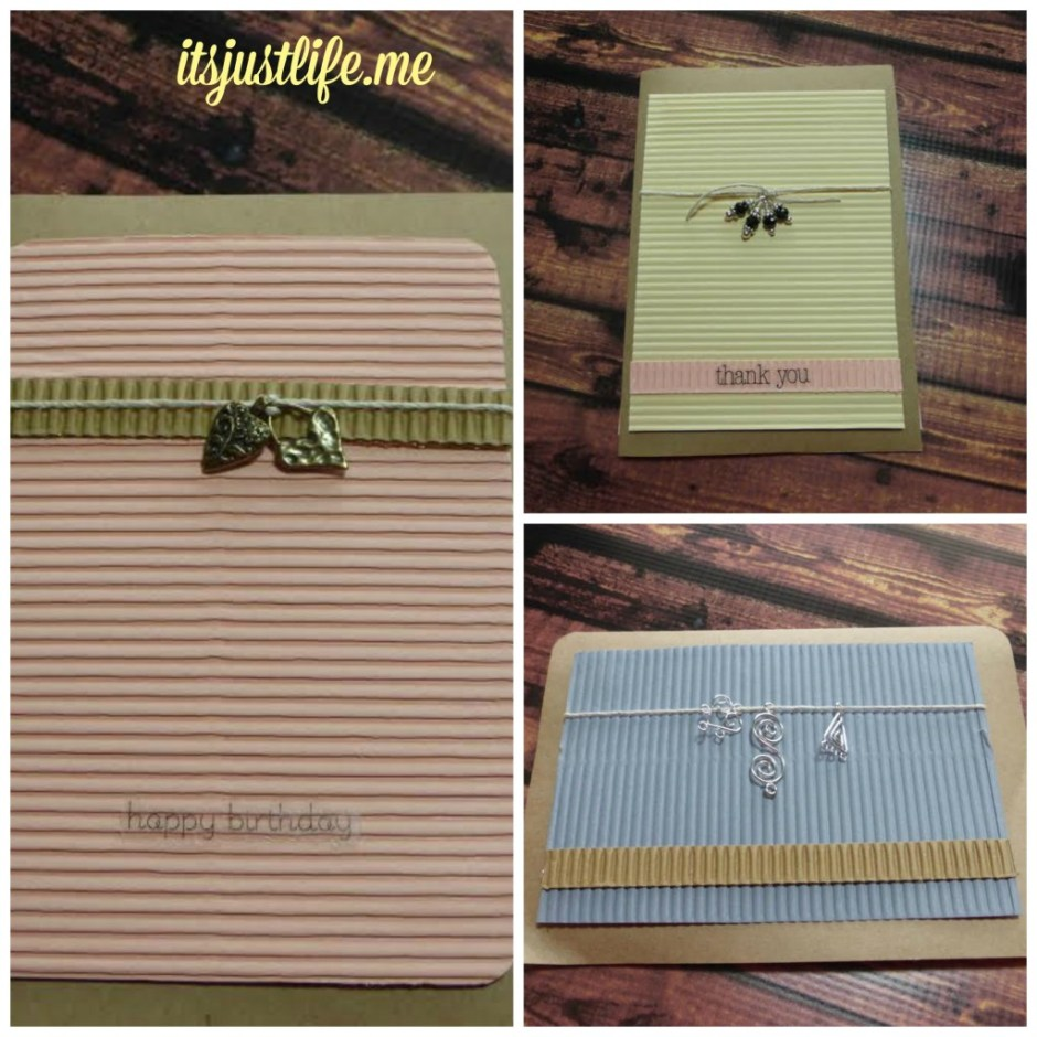 Using corrugated paper and charms on craft paper cards creates a unique look.