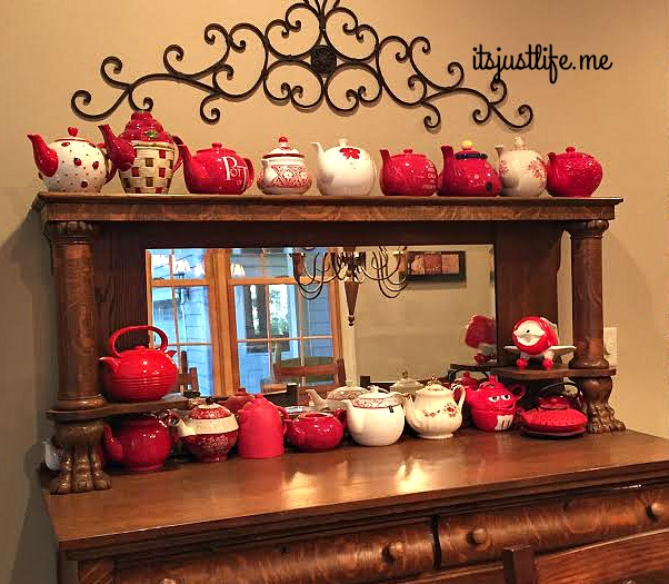 The antique buffet that Chris's dad refinished holds most of my red teapots.