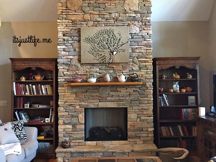 The living room features the rustic teapots on the mantle and some of the fall themed ones sprinkled around on the bookcases for good measure.