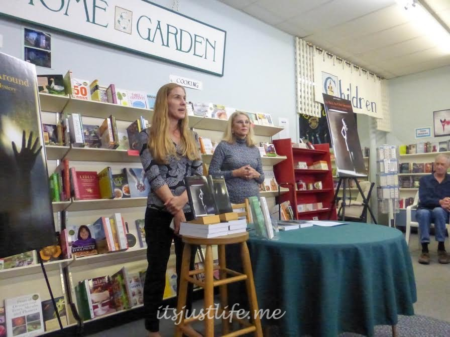 Highland Books co-owner Amanda Mosser introduces Adair Sanders to the group.