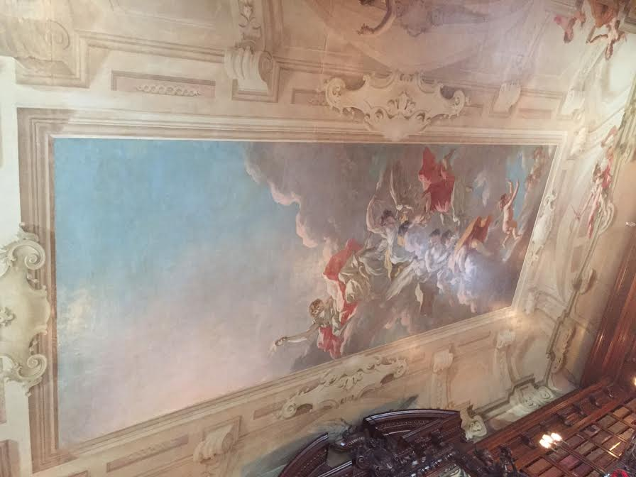 The ceiling is The Chariot of Aurora which was painted in the 1720's by artist Giovanni Pellegrini. It originally was located in the Pisani Palace in Venice.