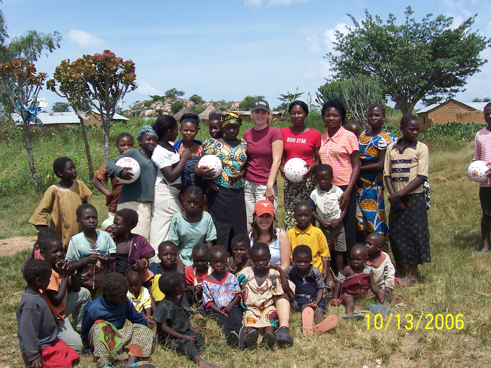 Handing out soccer balls to children in the village with the Munafos