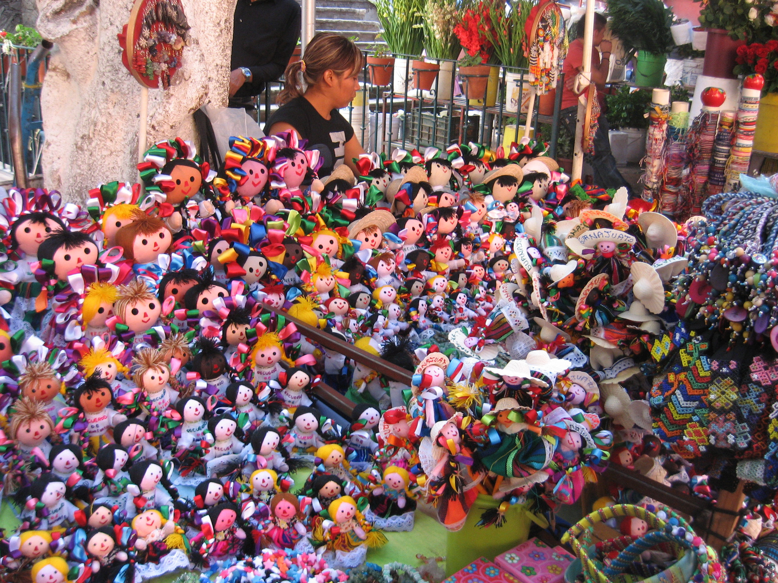 Children selling dolls at a stand in Monterrey