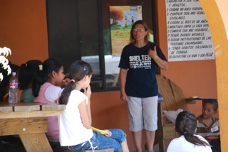Betty Betscher sharing a lesson with the older children during VBS