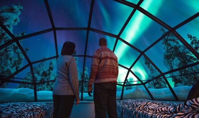 kakslauttanen-glass-igloo-inside-northern-lights