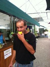 Ed sampling the peaches