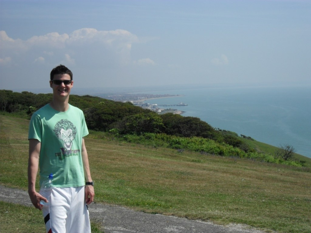 Mykel Mason, Doctor of Chiropractic pictured at Beachy Head in Eastbourne with Eastbourne in the background. Image taken by Mykel's mum.