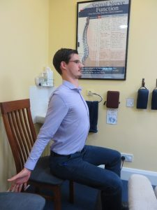 Image shows Mykel Mason, Doctor of chiropractic, demonstrating the Brugger exercise as explained in the step by step guide.