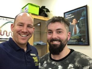 Image showing Doctor of Chiropractic James Revell with patient Chris.
