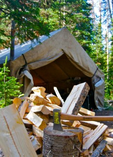 photo of chopping wood and walltent