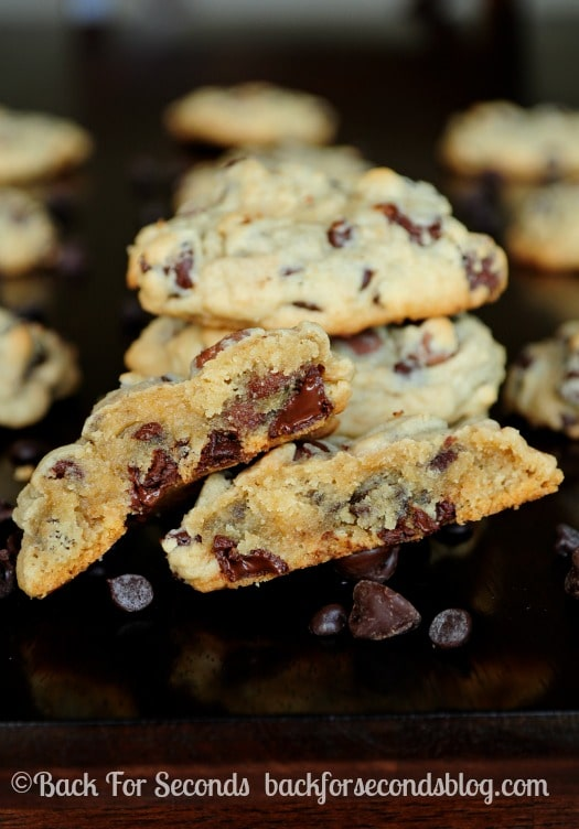 Learn how to make The PERFECT Soft Baked Chewy Chocolate Chip Cookie - These are so thick and chewy, and EASY!! https://backforseconds.com #chocolatechipcookie #recipe #dessert