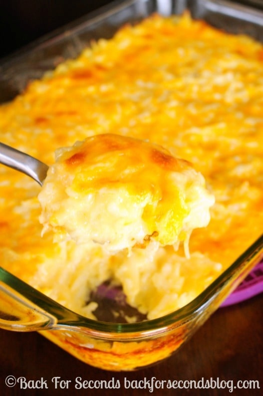 Cheesy Hash Brown Casserole - Everyone LOVES this!! https://backforseconds.com #holidaysidedish #casserole #cheeseypotatoes