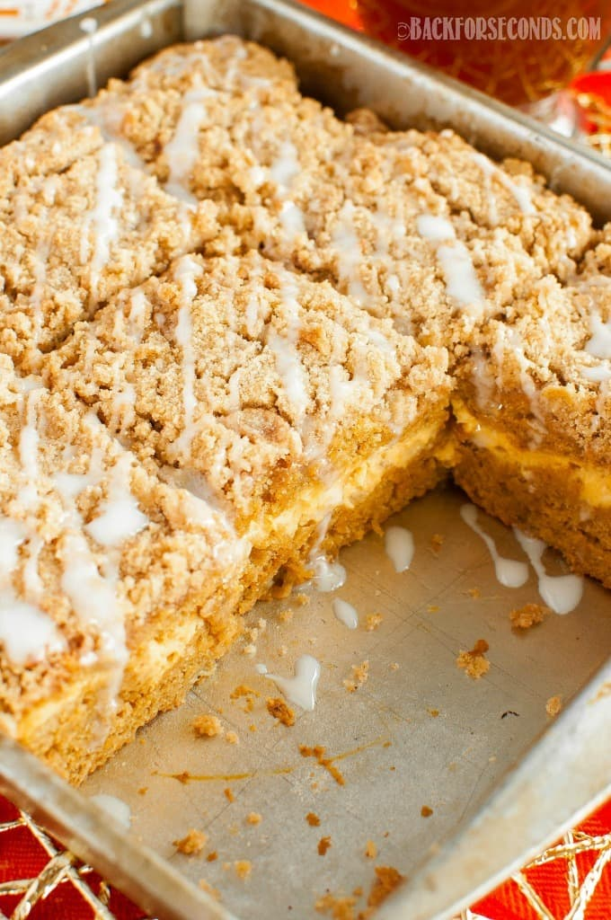 Pumpkin Cream Cheese Coffee Cake with Streusel is the ultimate fall recipe. This pumpkin spiced cake is great for holidays, breakfast, brunch, or dessert!