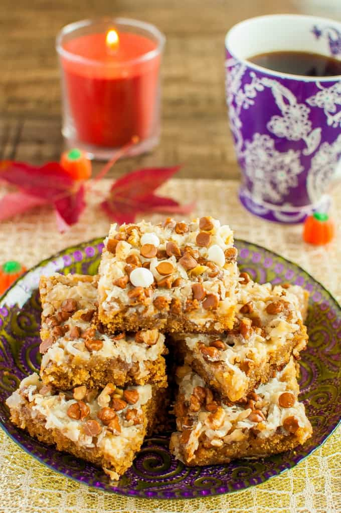Pumpkin Spice Magic Bars are similar to the classic seven layer bars, but these are all dressed up for fall! A gooey, chewy, easy fall dessert recipe!