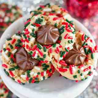 Chewy Christmas Sprinkle Cookies are so fun and festive, with (or without) a milk chocolate center! A secret ingredient makes them completely irresistible!